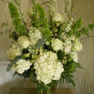 white and green in a vase